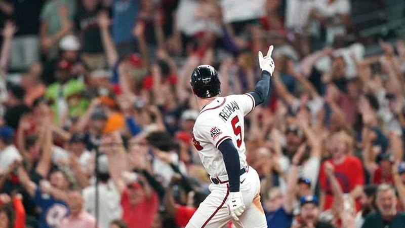 Atlanta Braves' Freddie Freeman (5) celebrates his solo homerun during the eighth inning of...