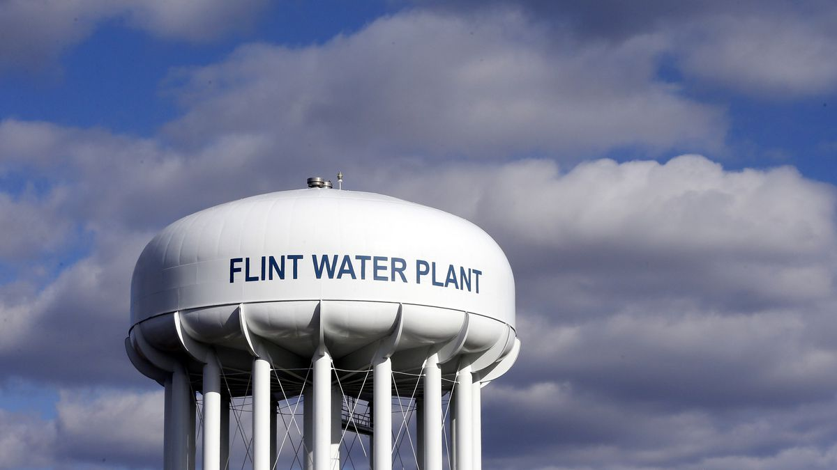 In this March 21, 2016, file photo, the Flint Water Plant water tower is seen in Flint, Mich....