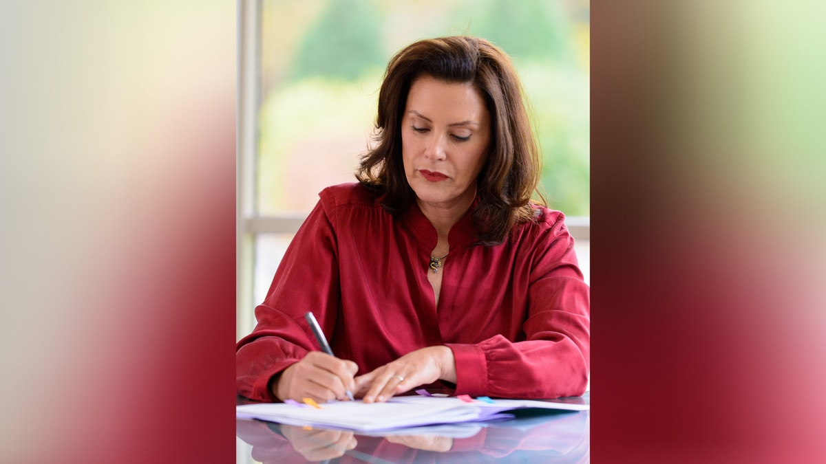 Michigan Governor Gretchen Whitmer signing Senate Bills 886 and 991 into law on October 20, 2020.