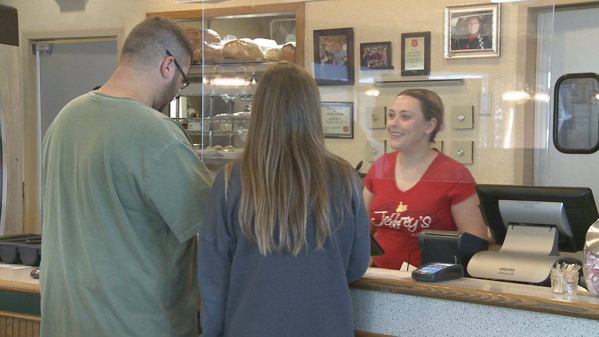 An employee serves customers at Jeffrey's Restaurant in Marquette.