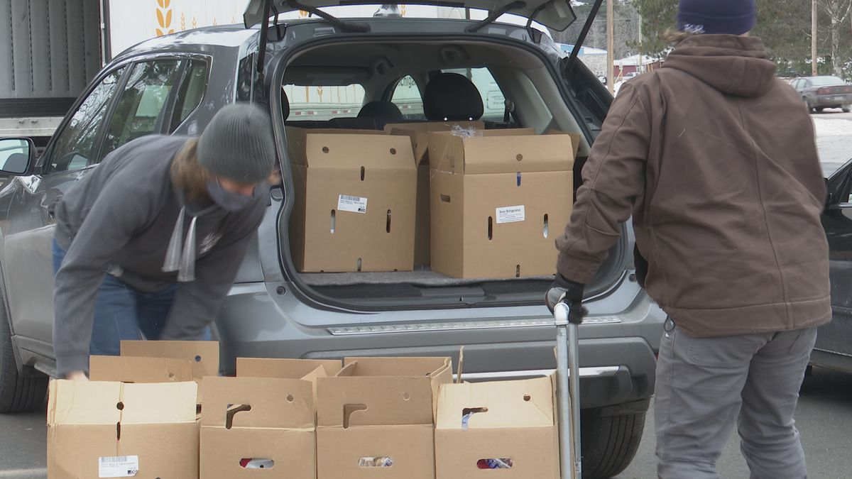 Volunteers filled vehicles with boxes of free food at Silver Creek Church during a food...