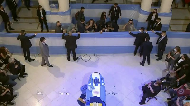 Thousands of fans bid farewell to soccer superstar Diego Maradona as he lies in state at...