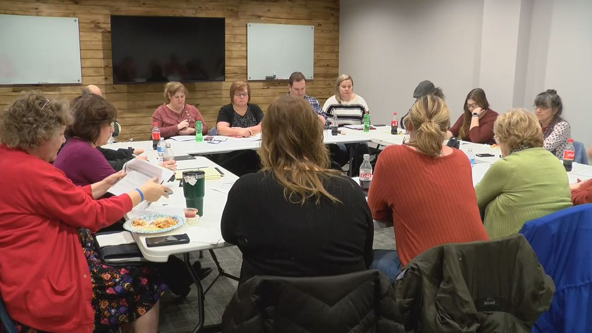 Dickinson County members sit and talk at community huddle. (WLUC Photo)