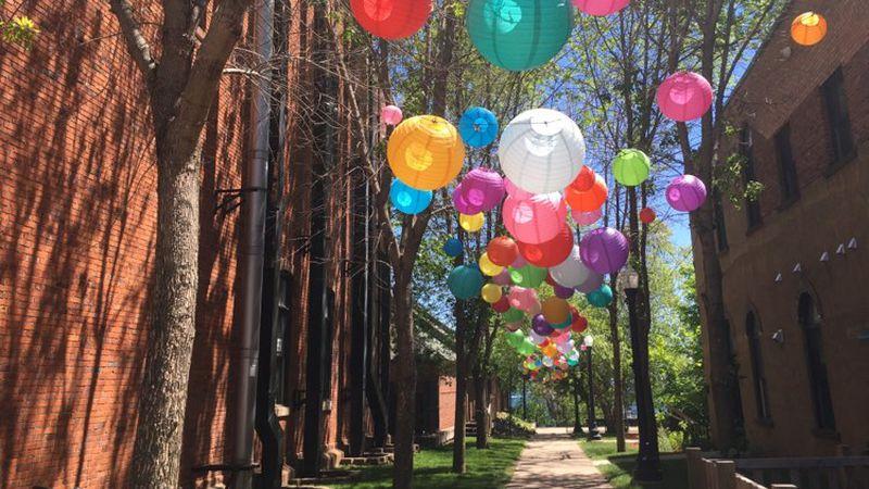 Colorful paper lanterns displayed in Marquette's Rosewood Walkway ahead of Art Week 2021.