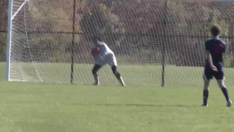 NMU's Alex Weaver  makes one of his four saves in a contest against Saginaw Valley State