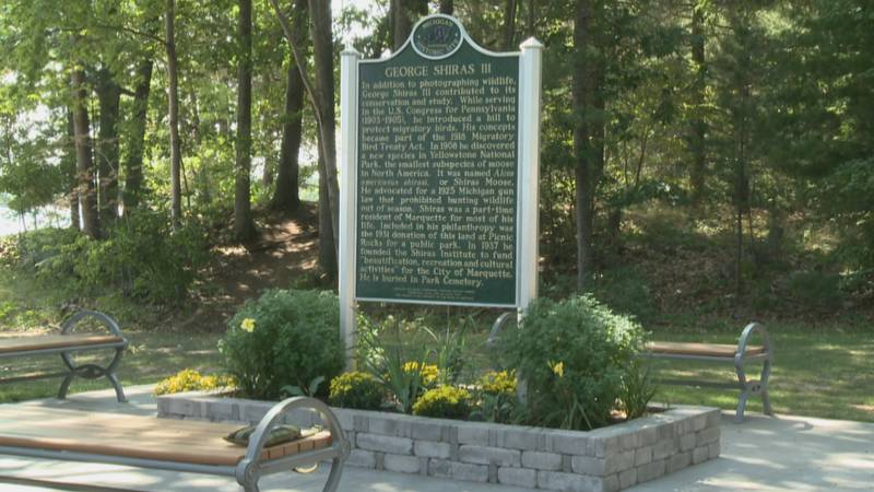 The state marker is located along the bike path in Shiras Park.