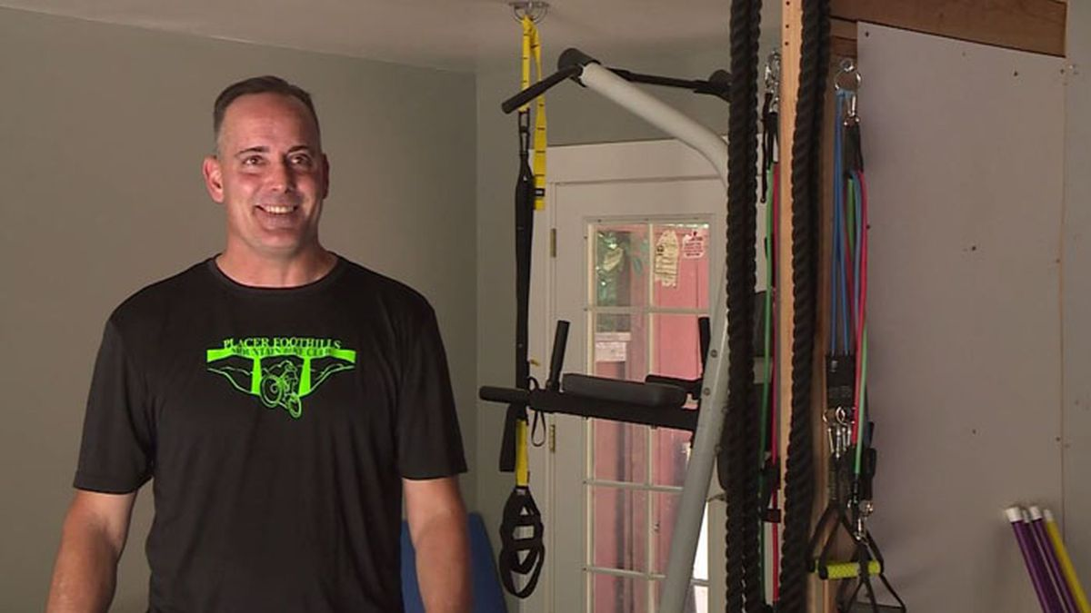 Jared Sellers, an adaptive PE teacher from Auburn, California, renovated his garage into a home gym for virtual classes necessitated by the COVID-19 pandemic. He says all the effort has been worth it. (Source: KOVR/CNN)