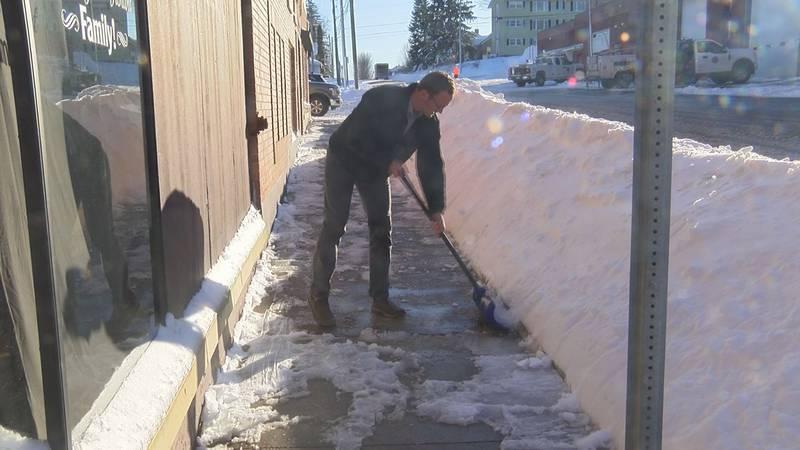 A U.P. resident shovels his walk-way. (WLUC Photo)