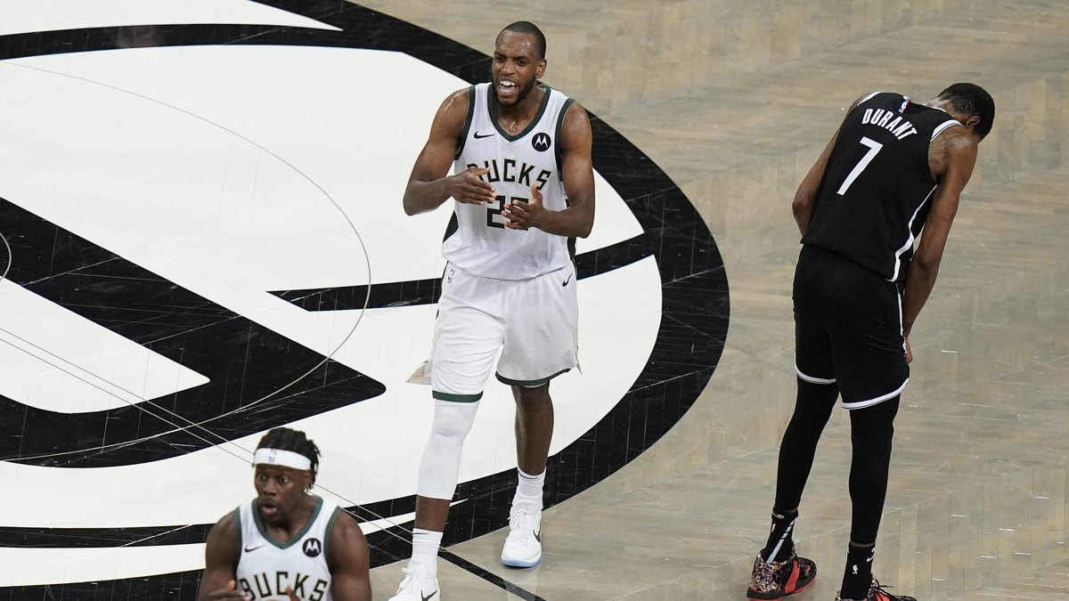 Brooklyn Nets' Kevin Durant (7) reacts after missing a shot as Milwaukee Bucks' Khris Middleton...