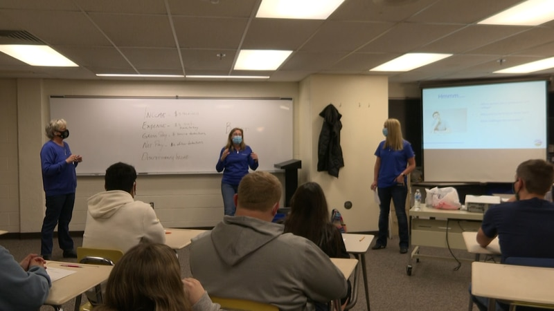 Range Bank employees stop by Negaunee HS to teach seniors how to properly manage a budget and...