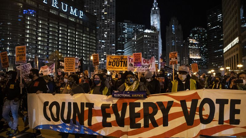 Protesters march through the Loop to demand every vote be counted in the general election,...