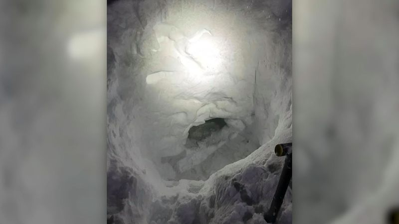 A 17-year-old dug out a snow cave after he got separated from his family while snowmobiling.