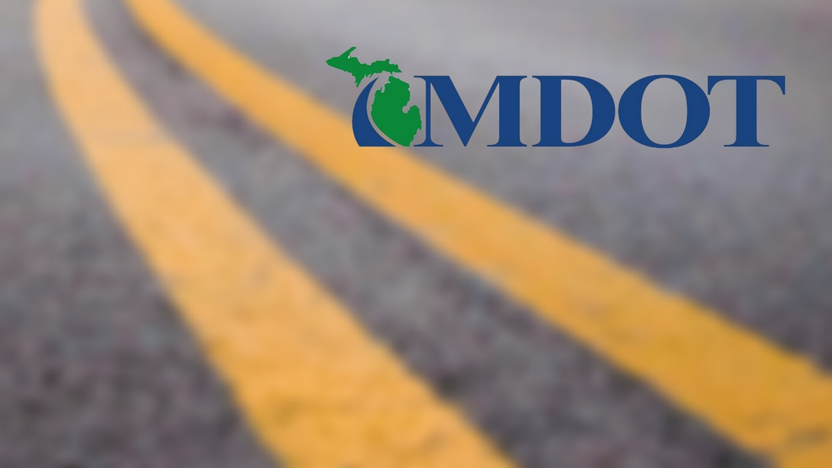 Michigan Department of Transportation logo on road image.
