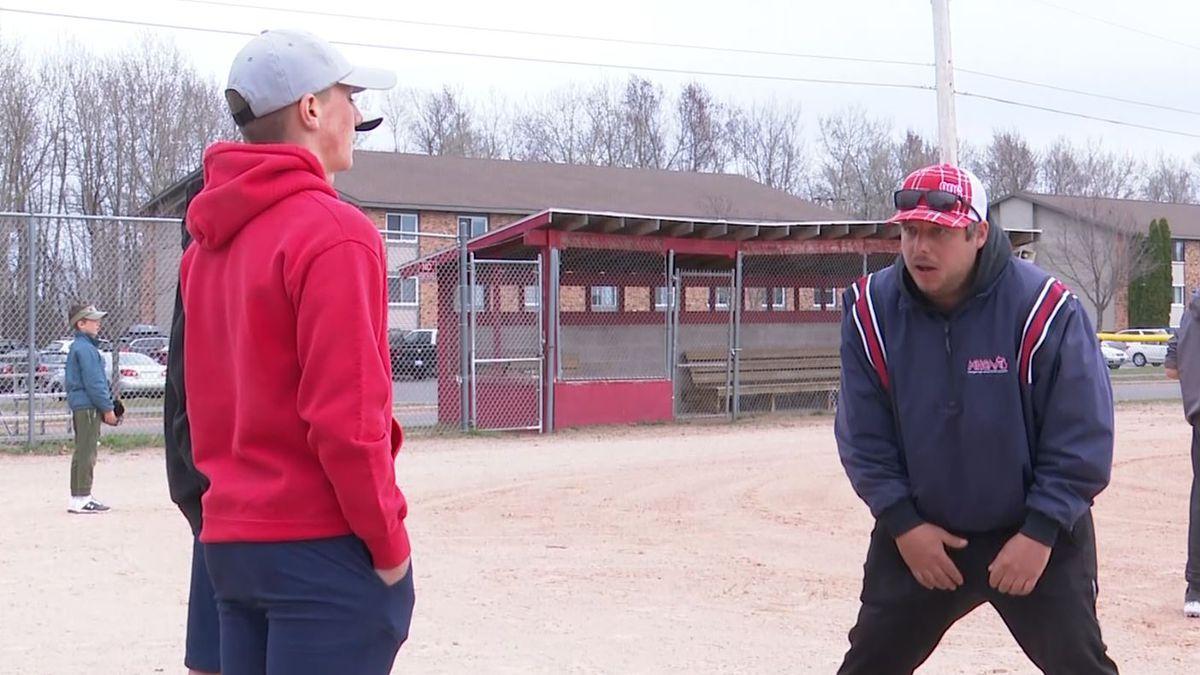 Marquette Little League's head umpire teaches new officials the basics.