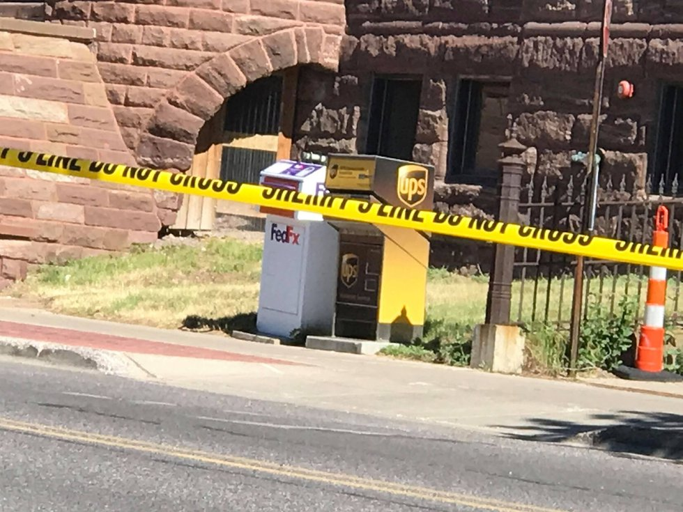 Caution tape on the 200 Block of Washington Street in downtown Marquette, Tuesday, June 15, 2021.