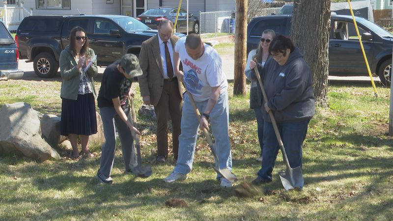 The Hodge family broke ground for the building of their new house.