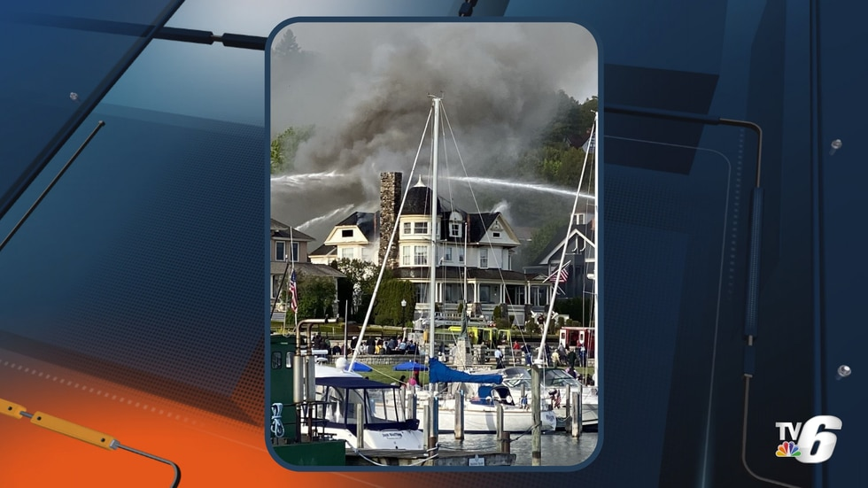 The Stingel family looks on as firefighting crews put out the fire at the Brigadoon Cottage on...
