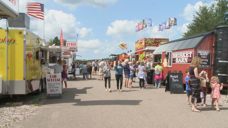 Fair attendees enjoy food from the many vendors.