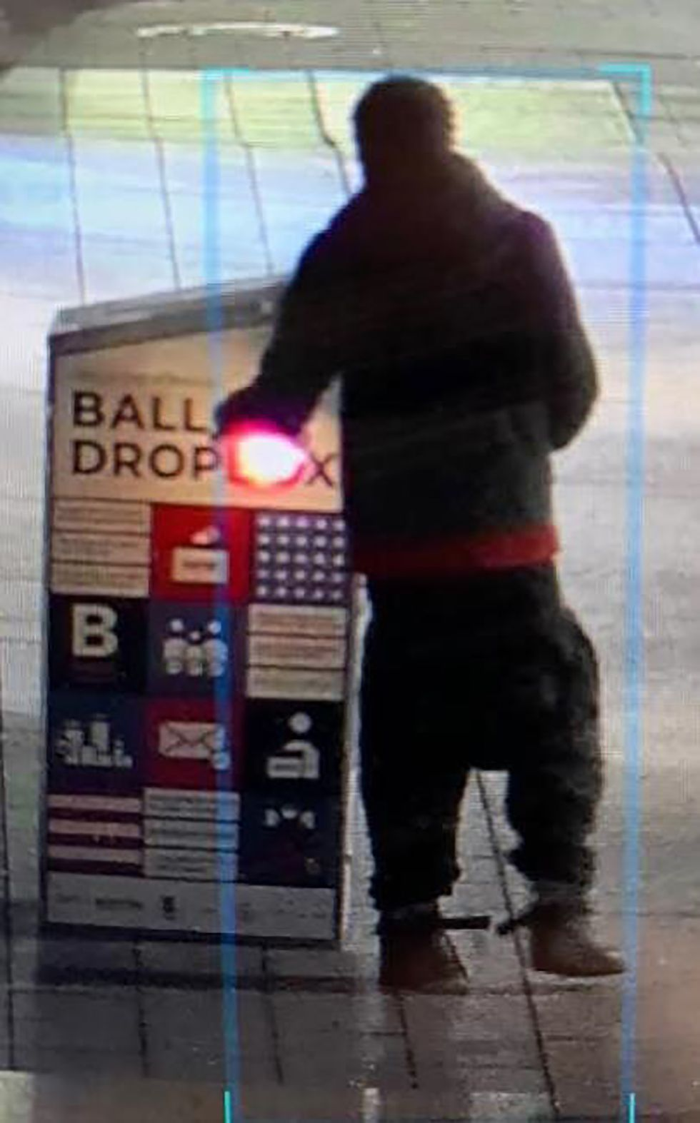 This surveillance image provided by the Boston Police Department shows a man approaching a...