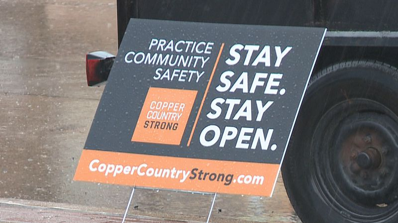 A Copper Country Strong sign outside a small business.