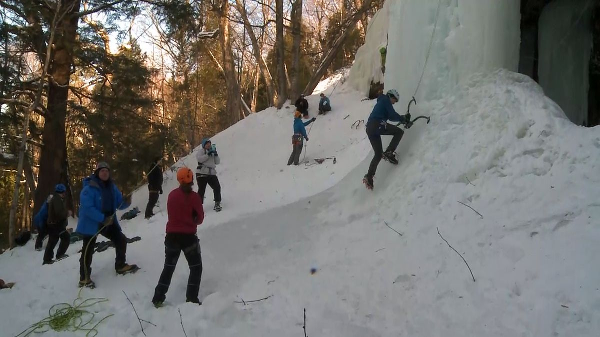 Climbers ascend walls of ice during Michigan Ice Fest in Munising.
