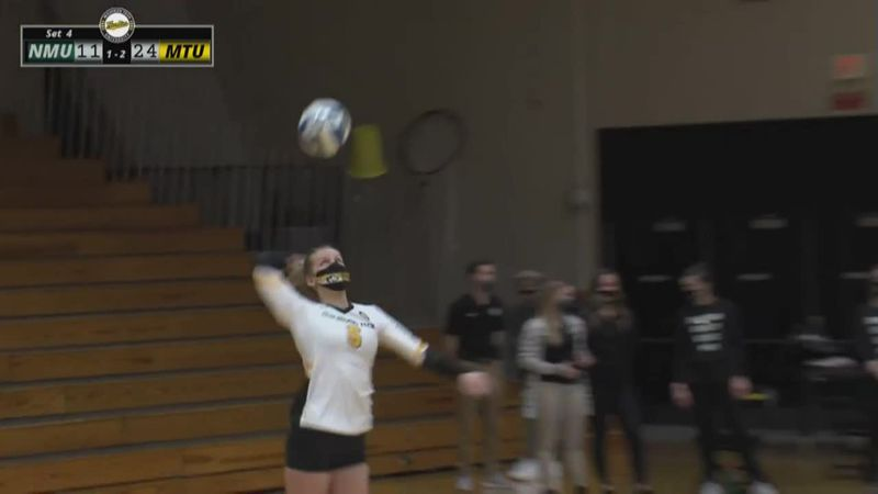 Michigan Tech's Grace Novotny serves an ace to wrap up a victory over Northern Michigan