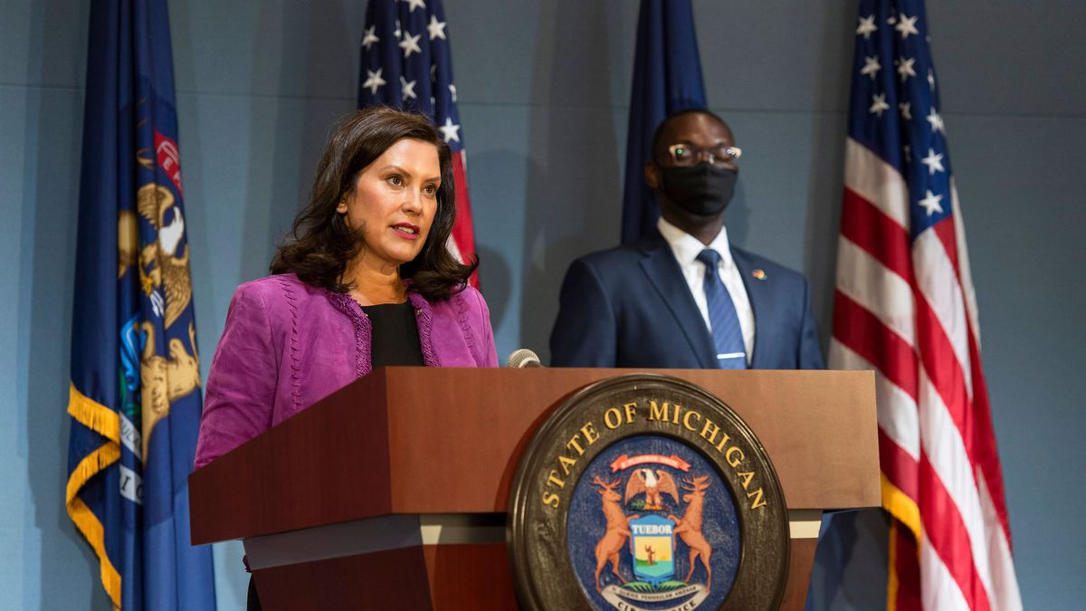 Gov. Gretchen Whitmer, front, provides a COVID-19 update on August 5, 2020. Lt. Gov. Garlin Gilchrist II looks on.