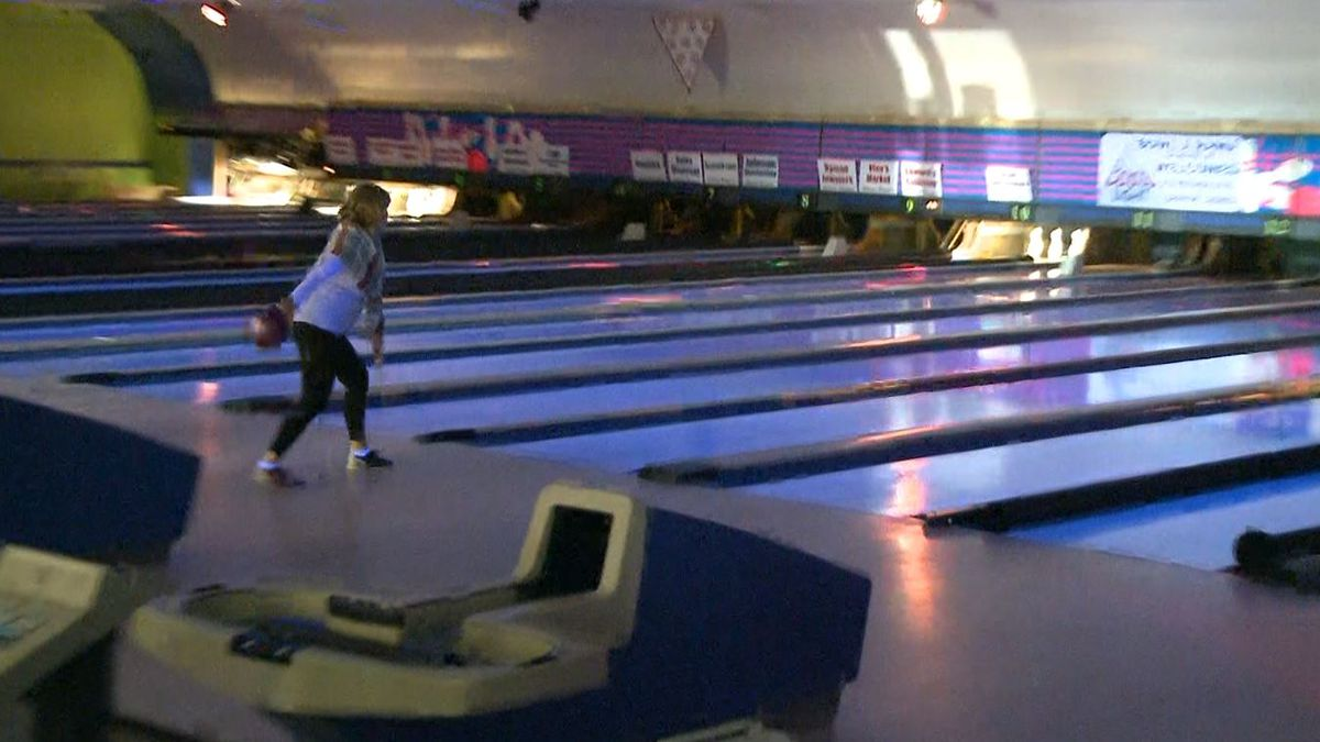 Lady throwing bowling ball. (WLUC photo)