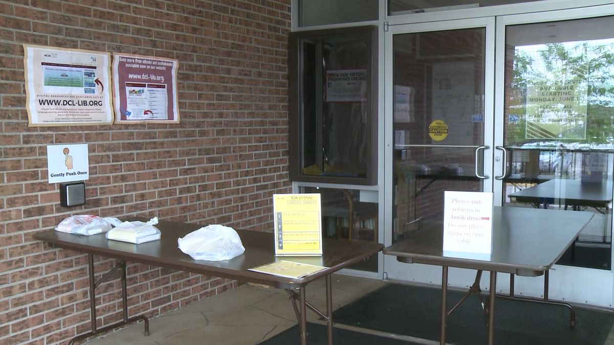 Books are set out at the Dickinson County Library for patrons to pick-up. (WLUC Photo)