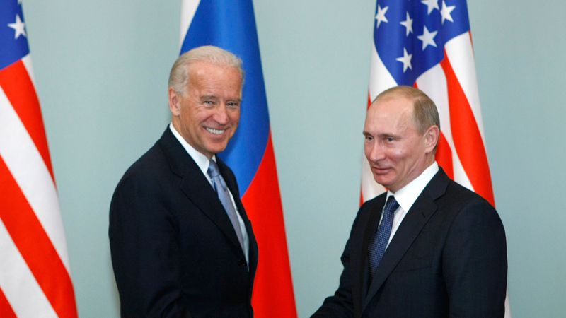 In this March 10, 2011, file photo, then-Vice President Joe Biden, left, shakes hands with...