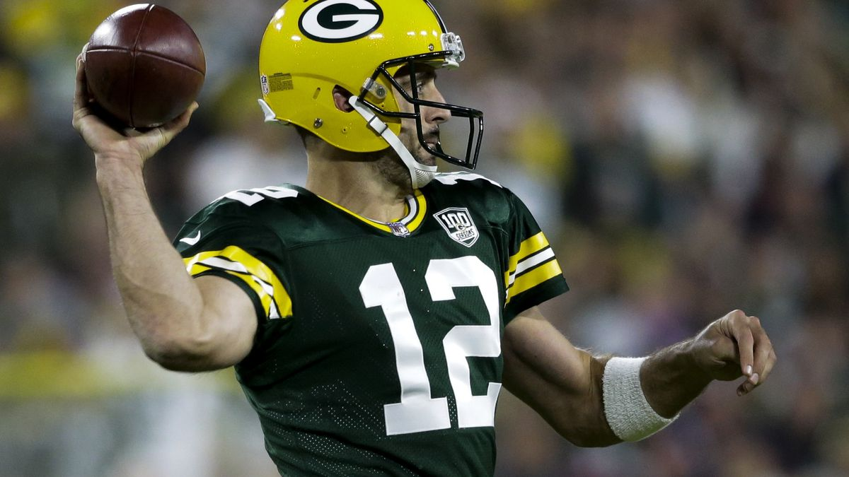 Green Bay Packers' Aaron Rodgers throws during the second half of an NFL football game -against...