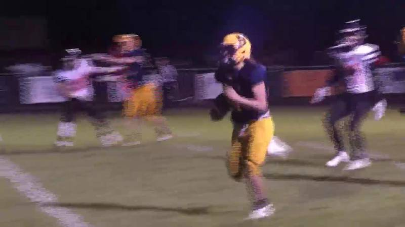 Negaunee's Nico Lukkarinen scores from 17 yards to give the Miners a 20-6 lead over the Gremlins.