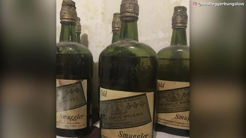 Couple finds 66 bottles of whisky in their home while doing renovations.