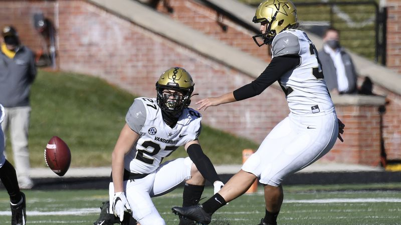 Vanderbilt's Sarah Fuller, right, kicks off as Ryan McCord (27) holds to start the second half...