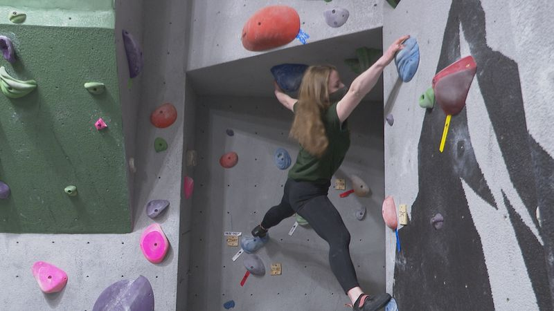 Indoor rock wall at True North Outpost