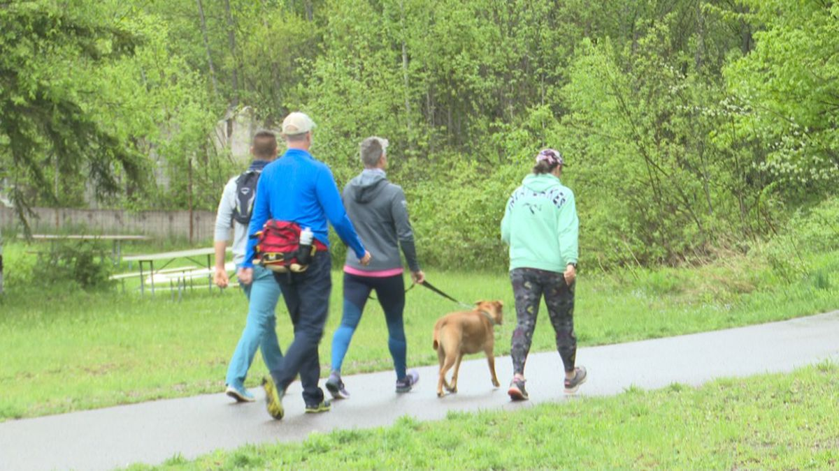 A small group of walkers starts their virtual U.P. Pink Power Walk from the RAMBA Trailhead in Ishpeming, May 30, 2020 (WLUC Image).