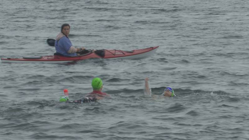 Some swimmers competed in the quarter mile 'Short and Sweet' swim.