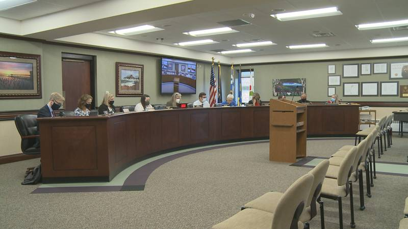 The City Commission discusses the budget at a meeting Monday evening.