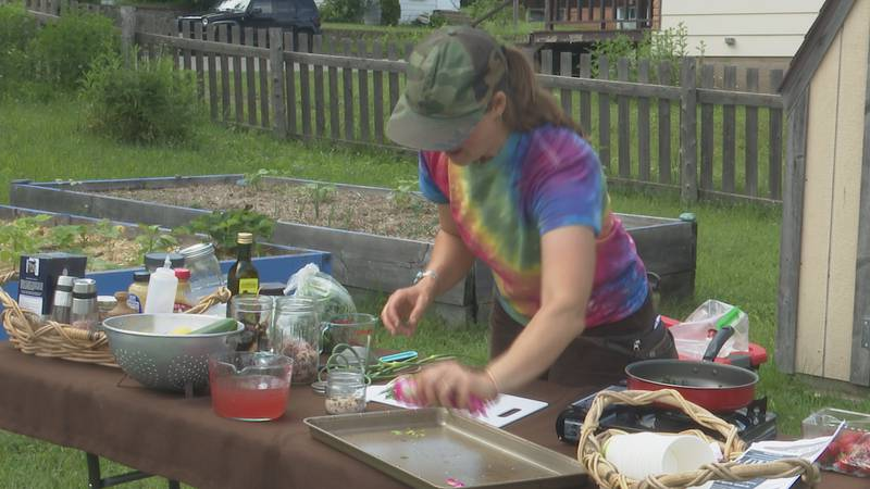 Partridge Creek Farms' May Tsupros taught volunteers to make healthy salad dressing.