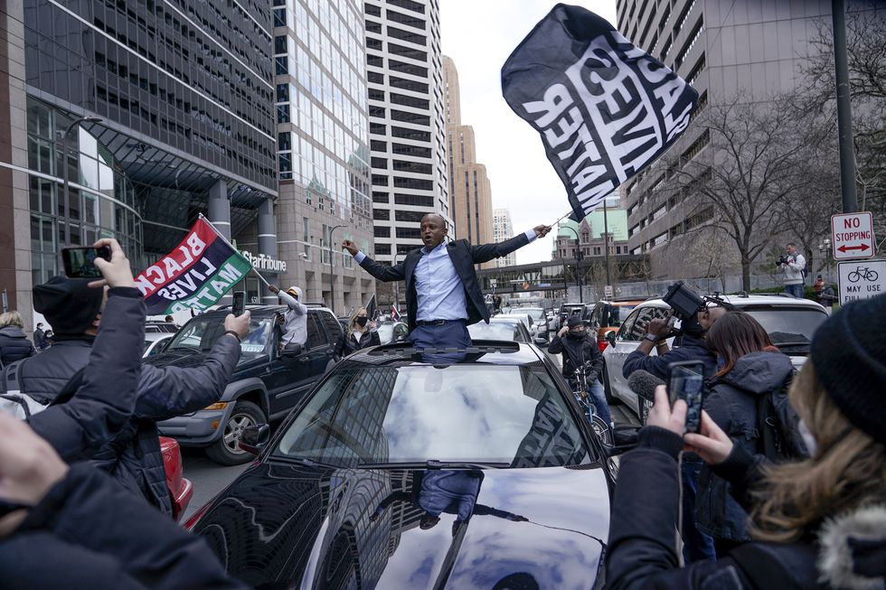 People rally outside the courthouse in Minneapolis on Tuesday, April 20, 2021, after the guilty...