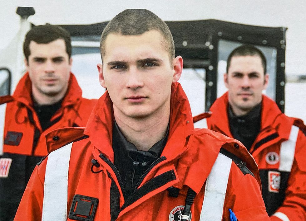 n this photo from March 30, 2009, Petty Officers 3rd Class Jeremy Sergey, front, Dan Fraley,...
