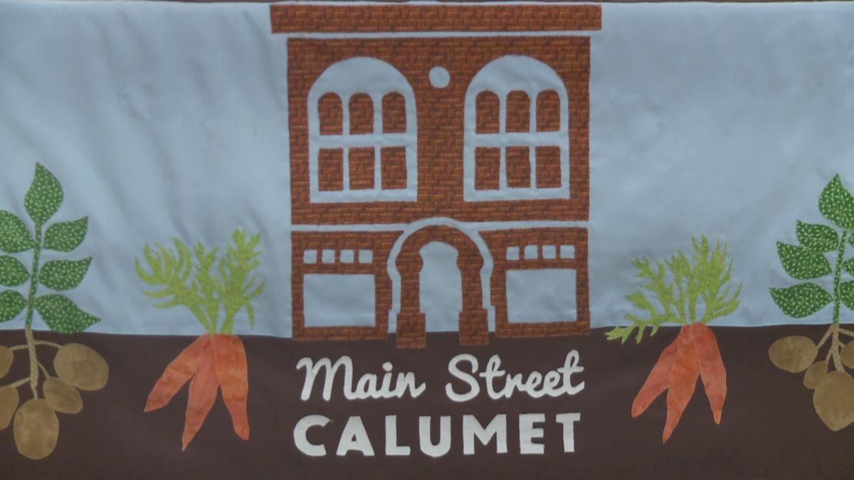 Main Street Calumet banner at the farmers market.