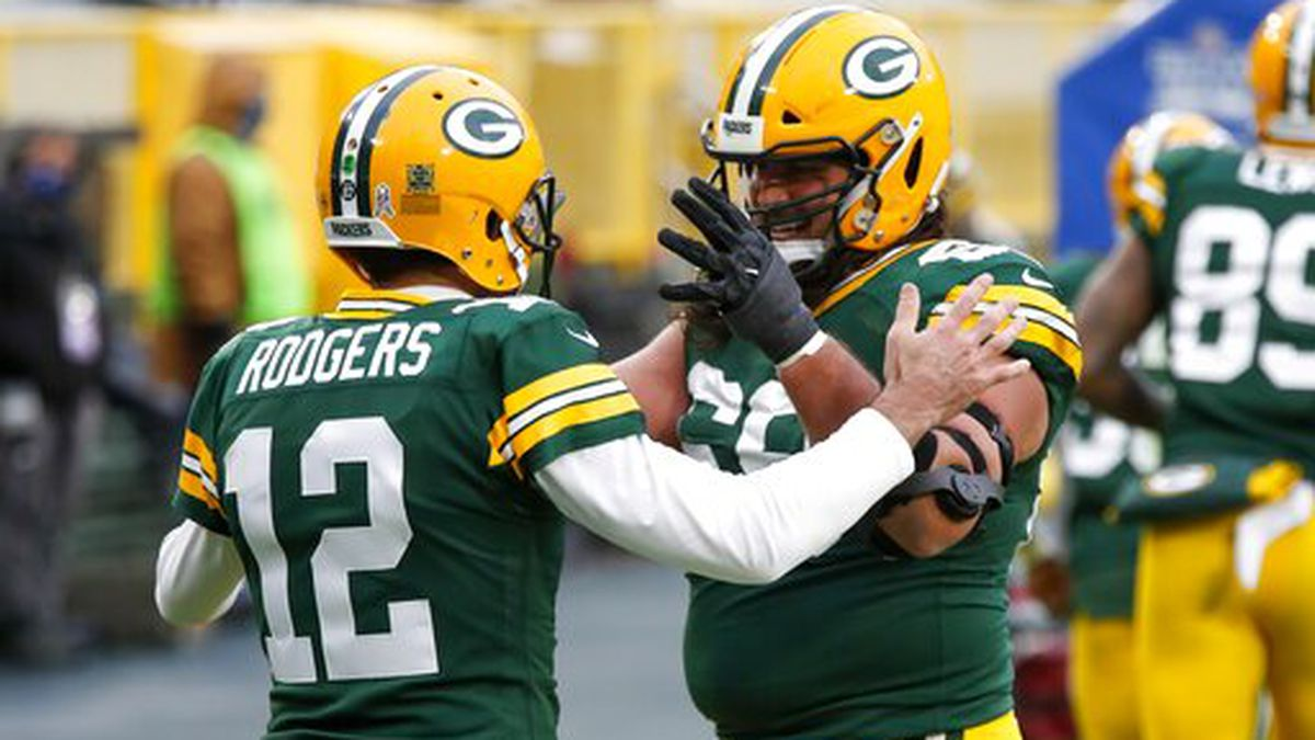 Green Bay Packers' Aaron Rodgers celebrates his touchdown run with David Bakhtiari during the...