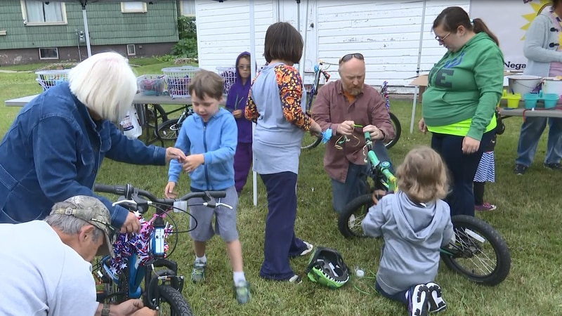 Kids used supplies to decorate bikes before parading through Negaunee