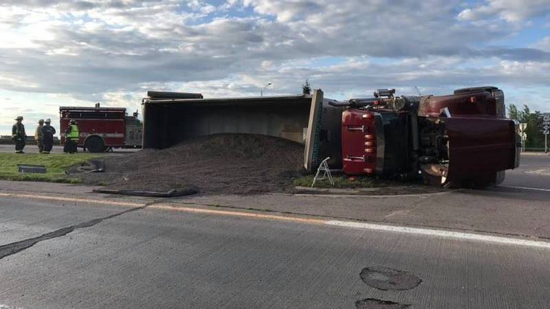 A semi-truck has overturned at a roundabout in Marquette on Thursday.