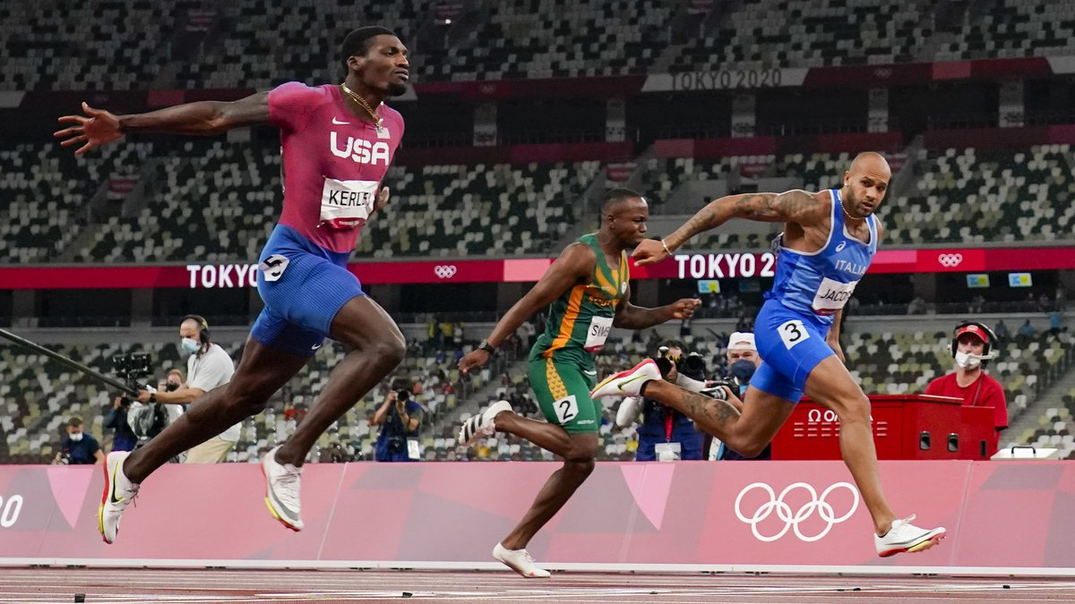 Marcell Jacobs, right, of Italy, wins the men's 100-meter final at the 2020 Summer Olympics,...
