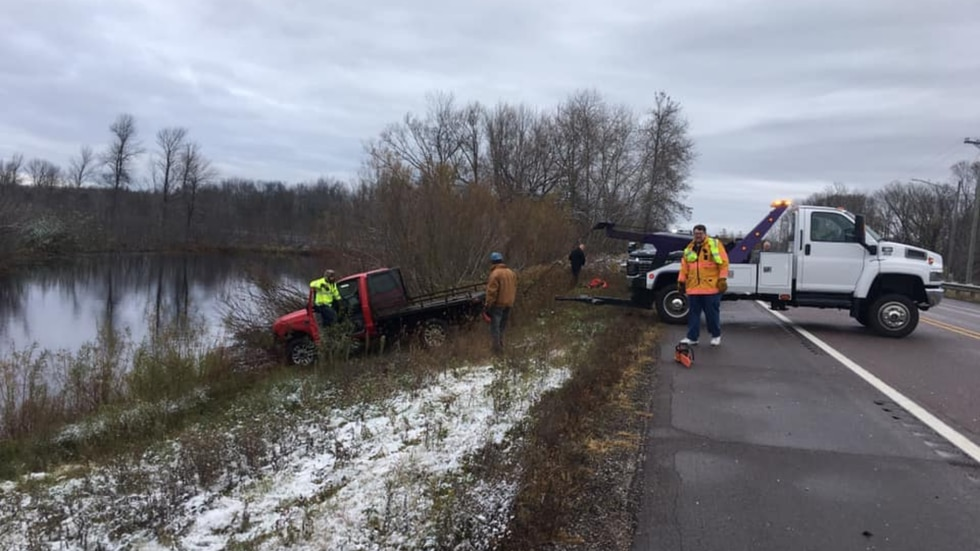 A truck being pulled from the Cedar River in Menominee County on the morning of Oct. 26, 2020.