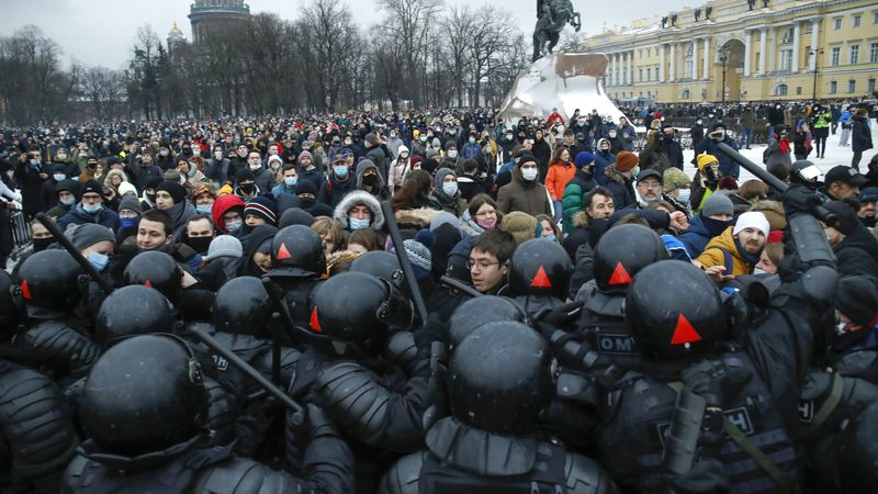 People clash with police during a protest against the jailing of opposition leader Alexei...