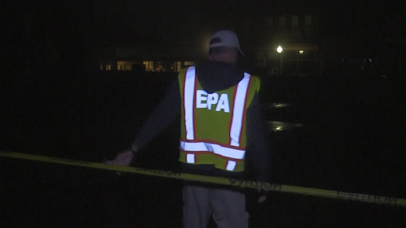 EPA On-Site Coordinator Brian Kelly steps into the cleanup site early Friday morning.