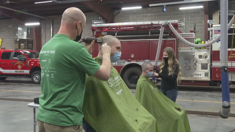 Ten firefighters shaved their heads in support of childhood cancer.